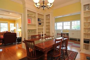 Eclectic Dining Room with Chandelier, Hardwood floors, High ceiling, Carpet, Crown molding, Built-in bookshelf