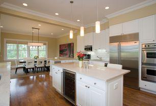 Contemporary Kitchen with Raised panel, Breakfast bar, full backsplash, U-shaped, Built In Refrigerator, Flush, Subway Tile