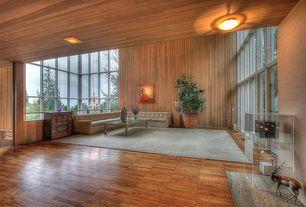 Modern Living Room with Hardwood floors, interior brick
