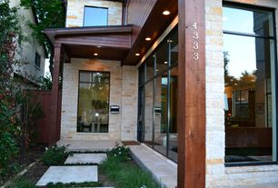 Contemporary Front of Home with stone siding, picture window, French doors, exterior stone floors, Pathway, Fence