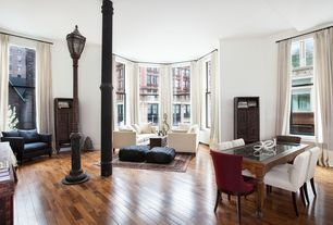 Eclectic Great Room with Crown molding, High ceiling, double-hung window, Hardwood floors