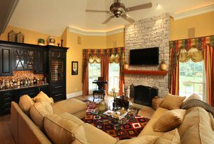 Traditional room with stone fireplace, Ceiling fan, Laminate floors, Built-in bookshelf