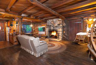 Rustic Living Room with Hardwood floors, Columns, Macy's - elston windsor rocking chair, Built-in bookshelf, flush light