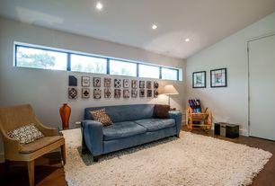 Eclectic Living Room with High ceiling, Hardwood floors, can lights, picture window, flat door
