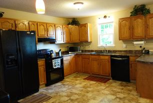 Traditional Kitchen with U-shaped, Inset cabinets, stone tile floors, Standard height, Raised panel, Wall sconce, dishwasher