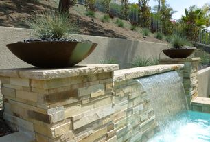Contemporary Landscape/Yard with Raised beds, Fountain, Pool waterfall feature, Outdoor pool, Pool, Fence, Pool features