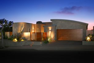 Modern Exterior of Home with Concrete siding, Glass gate, Natural wood garage door, Accent landscape lighting