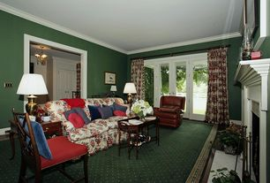 Traditional Living Room with French doors, Crown molding, Laminate floors, Cement fireplace