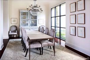 Traditional Dining Room with Crown molding, picture window, Hardwood floors, Standard height, Chandelier