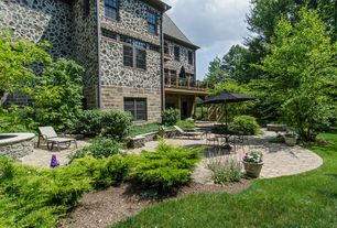 Traditional Patio with exterior stone floors, Raised beds