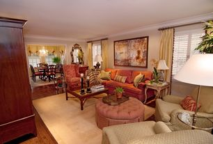 Traditional Living Room with Laminate floors, Crown molding, Chandelier