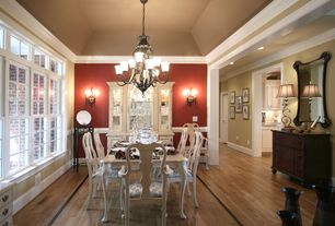 Traditional Dining Room with Wall sconce, Crown molding, Chair rail, Chandelier, Hardwood floors