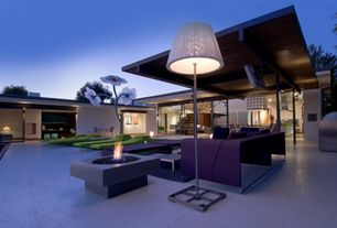 Contemporary Patio with exterior stone floors, sliding glass door, Fire pit, specialty window