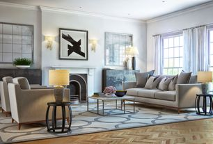 Contemporary Living Room with Cement fireplace, Michele Varian Marble Top Coffee Table, Crown molding, Built-in bookshelf