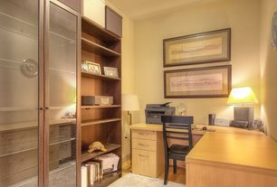 Contemporary Home Office with Built-in bookshelf, Standard height, Hardwood floors