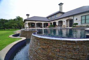 Mediterranean Exterior of Home with Infinity pool, double-hung window, Arched doorway, Outdoor pool, Tile roof