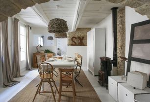 Eclectic Dining Room with Standard height, French doors, Fireplace, Wood Stove fireplace, Concrete floors, Pendant light