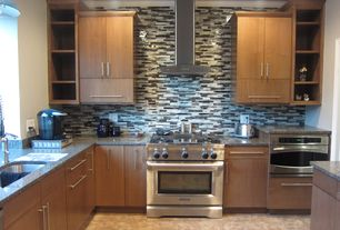 Modern Kitchen with Wall Hood, European Cabinets, Simple granite counters, Flush, Crown molding, full backsplash, L-shaped