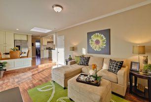Modern Living Room with Crown molding, flush light, Skylight, Hardwood floors, Sunken living room, Standard height
