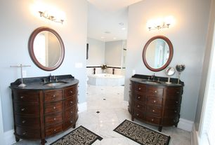 Traditional Master Bathroom with complex marble tile floors, Bathtub, can lights, Flat panel cabinets, Inset cabinets