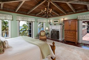 Traditional Master Bedroom with High ceiling, Fireplace, Chandelier, Exposed beam, Casement, Hardwood floors, Crown molding
