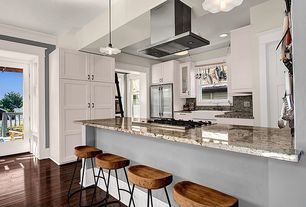 Contemporary Kitchen with French doors, Built In Refrigerator, Flat panel cabinets, full backsplash, electric cooktop, Flush