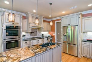 Eclectic Kitchen with Onyx counters, L-shaped, Kitchen island, Cabinet finish, Limestone Tile, Pendant light, Raised panel