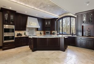 Traditional Kitchen with Crown molding, Inset cabinets, Simple granite counters, Glass panel, Stone Tile, Limestone Tile