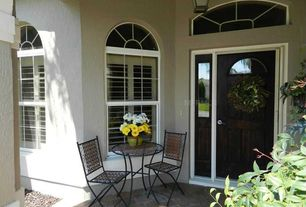 Traditional Porch with Arched window, exterior stone floors, Transom window, Glass panel door
