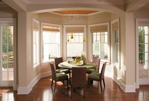 Traditional Dining Room with double-hung window, French doors, Pendant light, Hardwood floors, Standard height, Crown molding