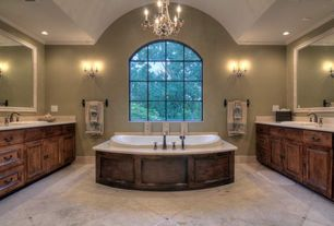 Traditional Master Bathroom with Raised panel, Wall sconce, soapstone tile counters, Arched window, Vinyl floors, Chandelier