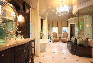Traditional Master Bathroom with Chandelier, Wall sconce, specialty door, Limestone counters, Raised panel, Freestanding