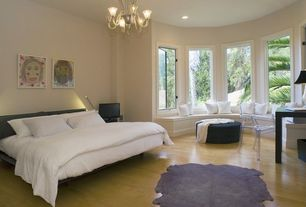 Contemporary Master Bedroom with picture window, Casement, Cowhide rug, can lights, Area rug, Chandelier, Window seat