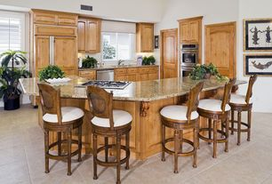 Traditional Kitchen with High ceiling, electric cooktop, Casement, partial backsplash, double wall oven, Framed Partial Panel