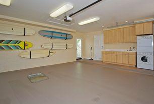 Modern Garage with French doors, Undermount sink, flush light, Concrete floors, specialty door