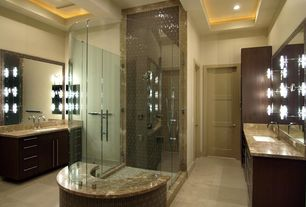 Contemporary Master Bathroom with Wall sconce, Denali imperium granite slab polished, specialty door, frameless showerdoor