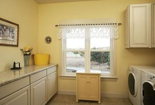 Country Laundry Room with Casement, stone tile floors, laundry sink, Undermount sink, Standard height