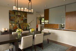 Modern Dining Room with flush light, Hardwood floors
