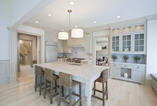 Traditional Kitchen with Glass panel, Custom hood, Flat panel cabinets, Crown molding, One-wall, Bamboo floors, Pendant light