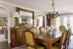 Traditional Dining Room with French doors, Chandelier, Crown molding, Hardwood floors