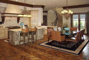 Traditional Great Room with French doors, Chandelier, can lights, Hardwood floors, Standard height, Crown molding, flat door