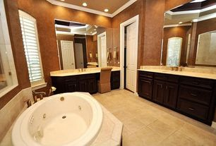 Mediterranean Master Bathroom with Master bathroom, Onyx counters, Raised panel, Onyx, Frameless, High ceiling, Vinyl floors