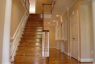 Traditional Staircase with curved staircase, Laminate floors, High ceiling, Wainscotting