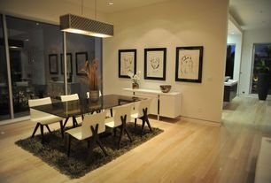 Contemporary Dining Room with Pendant light, Hardwood floors, Built-in bookshelf, Carpet, Columns, French doors