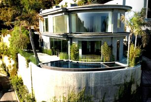 Modern Swimming Pool with Raised beds, Pathway, picture window, Fence, Deck Railing, Large picture windows, Pool with hot tub