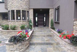 Modern Front Door with six panel door, Raised beds, Casement, exterior stone floors, picture window, specialty window