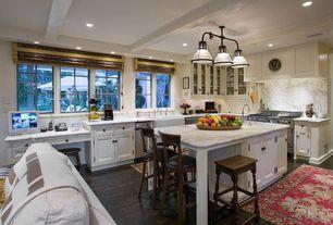 Traditional Kitchen with Kitchen island, can lights, Glass panel, Custom hood, Standard height, Raised panel, gas range