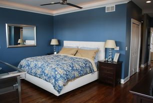 Modern Guest Bedroom with Hardwood floors, Fulcrum Gallery - Silver Slope Front Wall Mirror, Ceiling fan, Crown molding