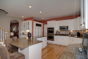 Traditional Kitchen with Simple granite counters, full backsplash, High ceiling, Large Ceramic Tile, double wall oven