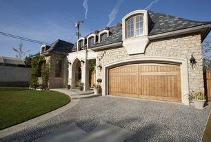 Mediterranean Garage with Gate, Arched window, exterior stone floors, Pathway, Bay window